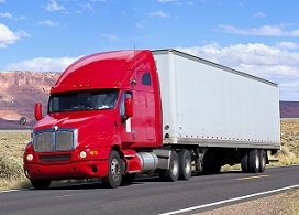 Blue sky over truck driving through Southwest USA